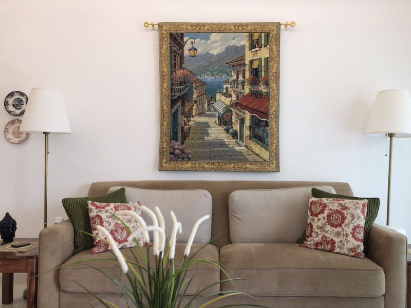 Bellagio Village tapestry hanging in a home