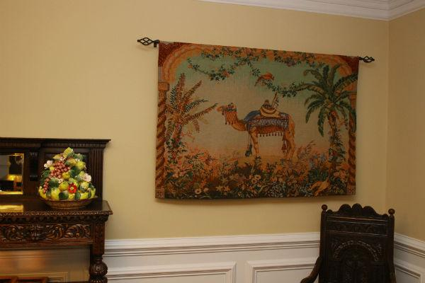 Camel tapestry hanging in a dining room