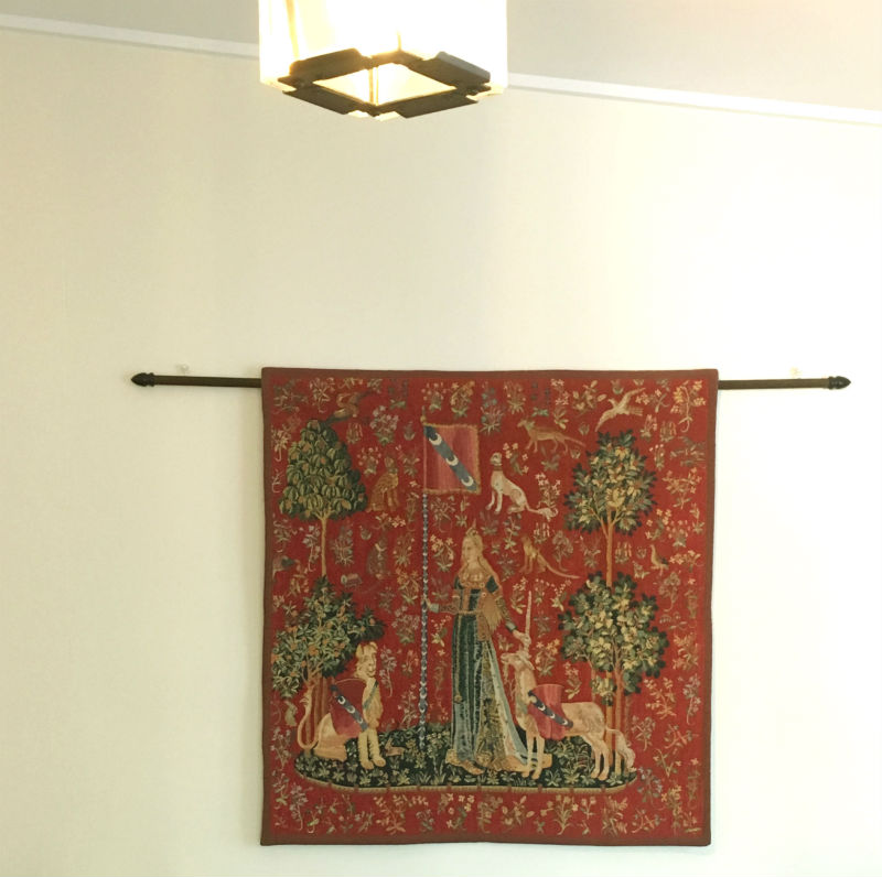 Cluny Museum Touch tapestry hanging in a home