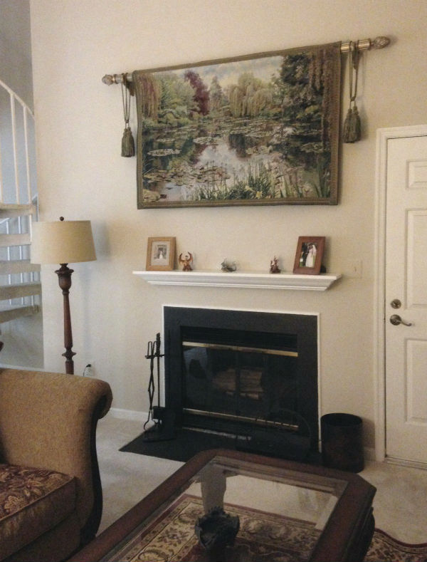 The Monet's Garden tapestry hanging above a fireplace