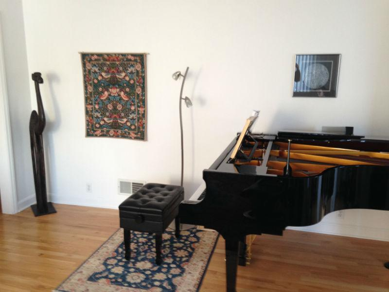 The Strawberry Thief tapestry next to a piano