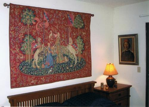 The Taste tapestry in a bedroom - Lady with the Unicorn tapestries